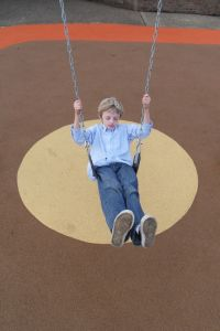 boy-on-swing-1158471-m
