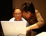 mom-and-dad-looking-at-laptop-672597-m
